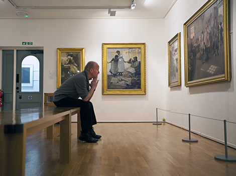 UK - Cornwall - Author Jim Crace in the room dedicated to paintings by the Newlyn School at the Penlee House Gallery